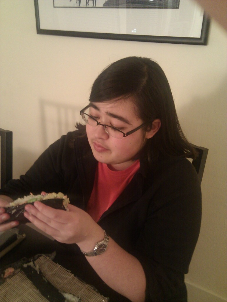 No one can claim Nikki isn't a yuppie! She ate a sushi burrito like the best of them. (Sushi is hard to make stick).